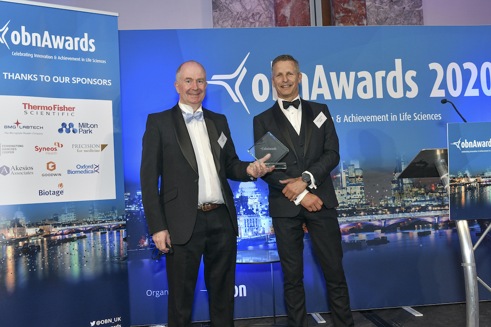 Domainex CEO Tom Mander collecting Best CRO award at OBN awards